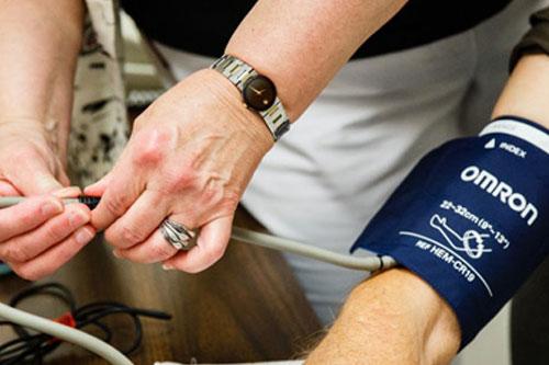 person getting their blood pressure taken