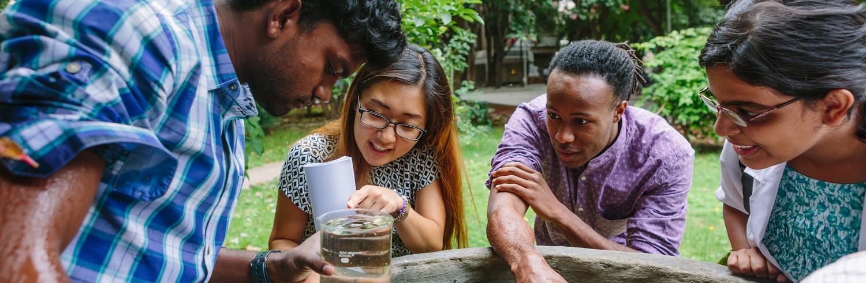 Students looking at a beaker