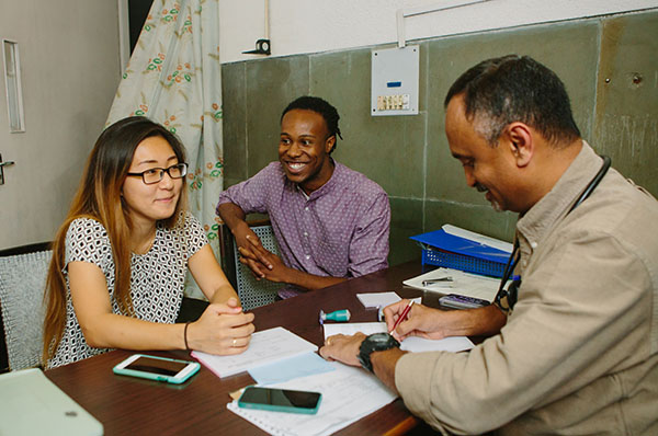 """Jang and Williams with a doctor from St. John's Medical College. """"Everyone at St. John's was so welcoming and helped acclimate us to the culture,"""" says Jang."""