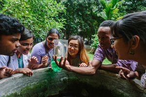 students looking at beaker