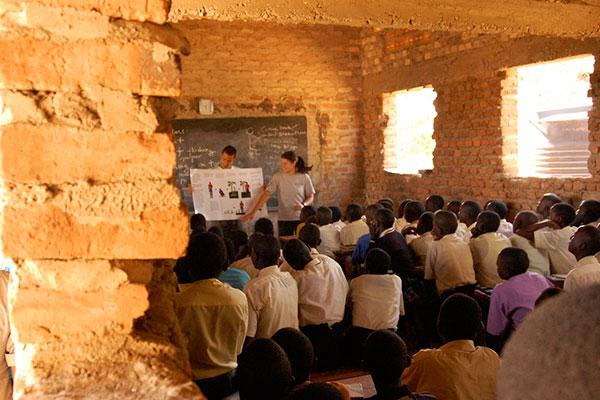 woman teaching in brick building