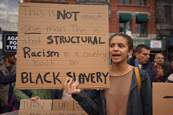 woman with protest sign