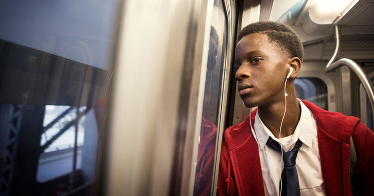 young person of color on train.