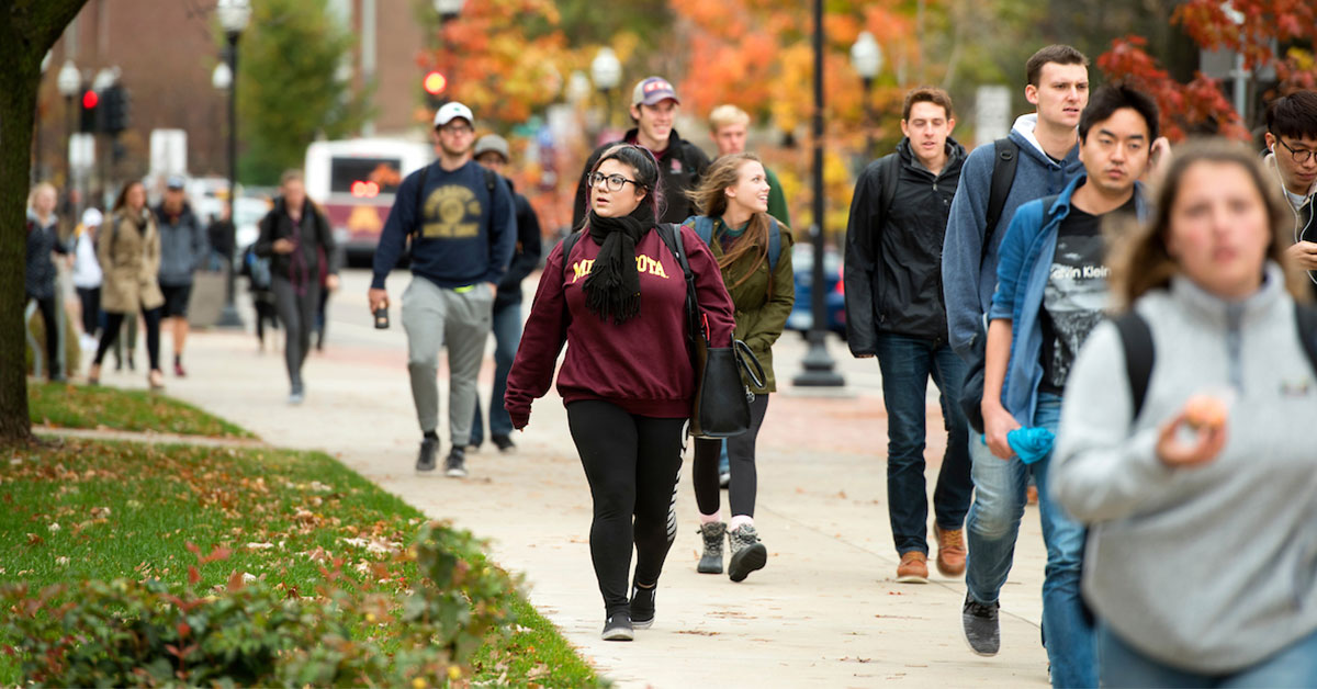 Students walking outdoors on the University of Minnesota campus