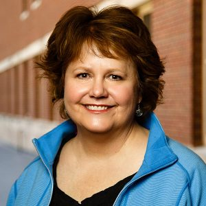 Lynn Blewett smiling.