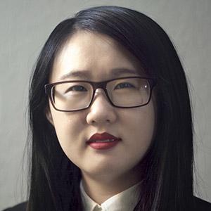 PhD student Xuanzi Qin wearing glasses
