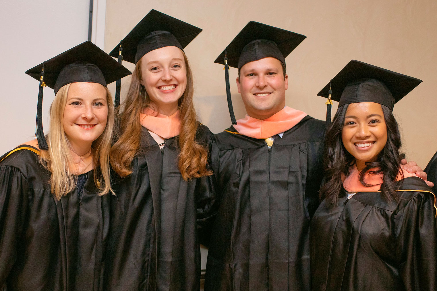 students smiling at the 2019 commencement ceremony