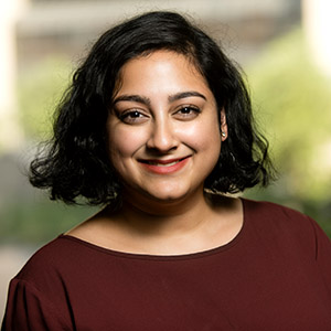 Manami Bhattacharya smiling.