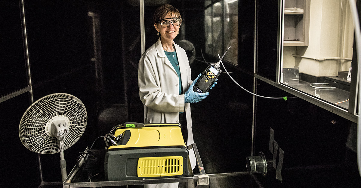 Susan Arnold taking a measurement inside her exposure chamber.
