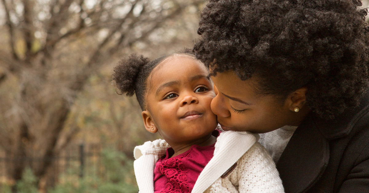 Happy African American mother and her daughter.