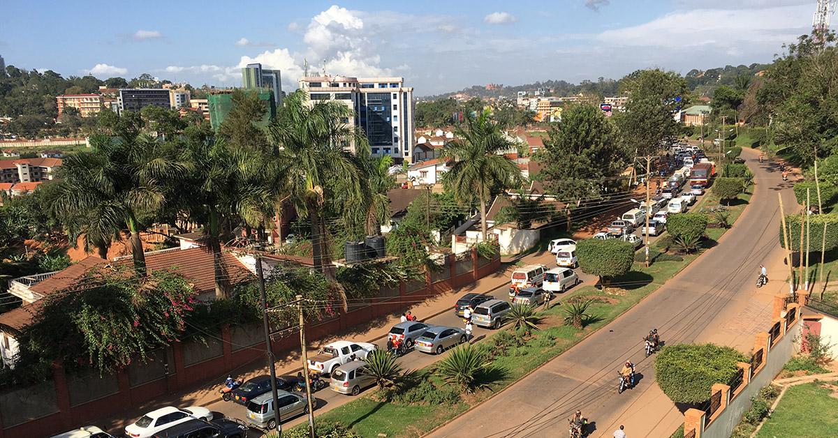 A city street and skyline in Kampala, Uganda.