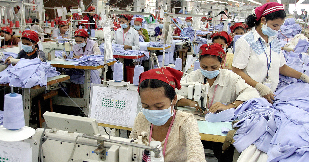 Cambodian women sewing in a garment factory.