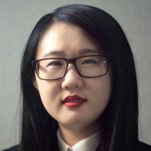 Xuanzi Qin wearing glasses.