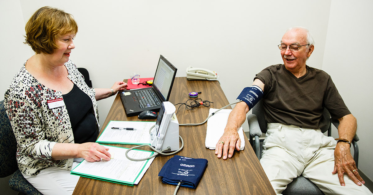 An ARIC participants gets his blood pressure checked.
