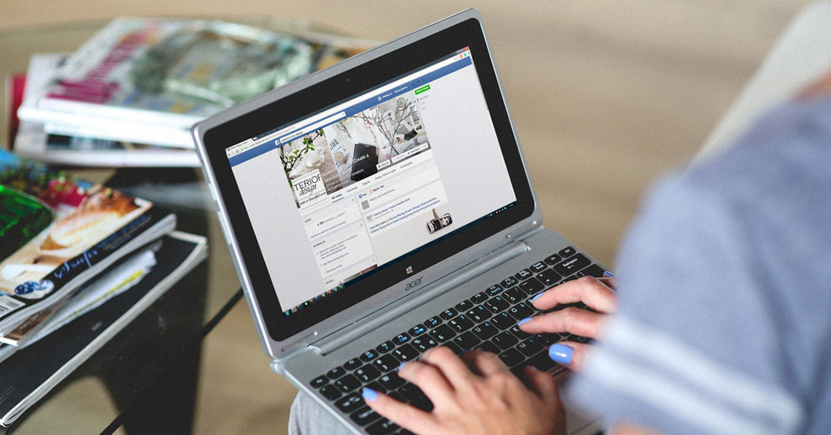 Woman using Facebook on a computer