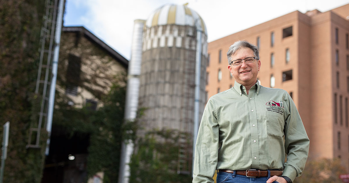 Jeff Bender standing in front of a silo on the St. Paul campus.