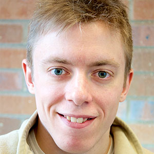 PhD student Collin Calvert smiling