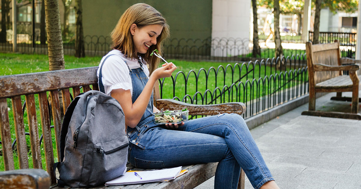 Student girl eating a healthy lunch