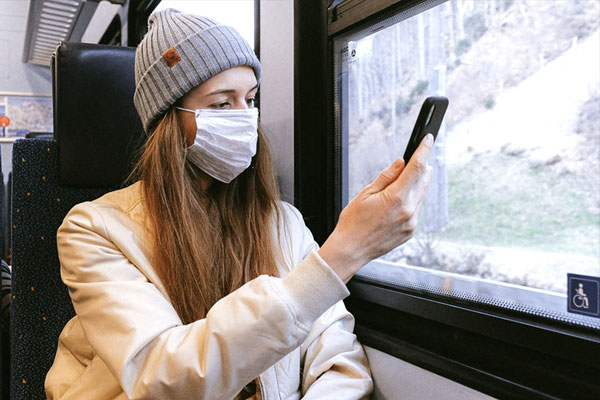 woman with mask on train
