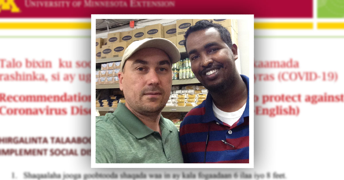 Serdar Mamedov stands next to a Somali grocery store owner.