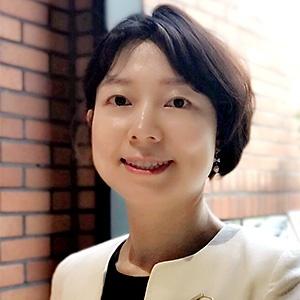 Yuni Choi smiling.