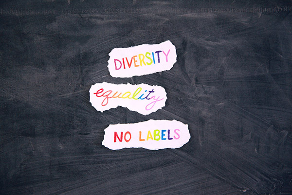 """diversity, equality, and """"no labels"""" written out on chalkboard"""