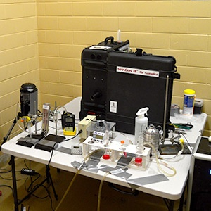 A variety of air samples on a table inside a testing space.