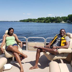 Joseph Akambase and wife on a boat
