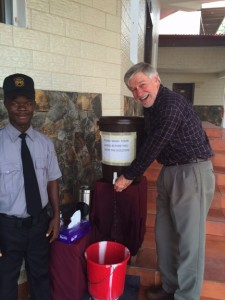 Jim Neaton in Monrovia at one of the handwashing stations that were outside every public building during the Ebola epidemic. Photo courtesy of Jim Neaton