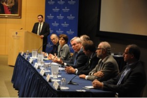 Michael Osterholm, table center in blue tie, spoke at Johns Hopkins University's Dean Symposium on October 20, 2014, on the scope and challenges of the then-current Ebola epidemic. Photo credit: Larry Canner, courtesy of Johns Hopkins Bloomberg School of Public Health