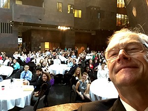 Dean Finnegan takes a selfie with nearly 300 new students at 2015 Orientation.