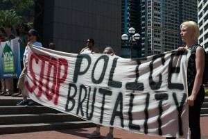 Protestors at a rally against police brutality in Minneapolis in 2013. (Source: Fibonacci Blue, Flikr Creative Commons)