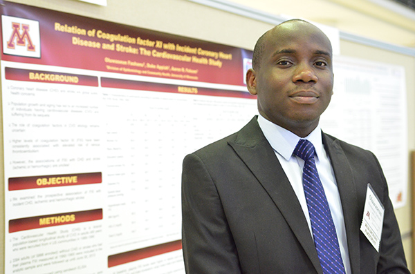 Student smiling by research poster