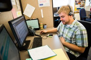 SPH student and Team D member Luke Magnuson conducts phone interviews.